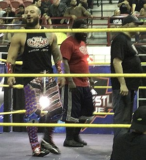 The Mecha Wolf 450 - Mr. 450 (left) as part of La Junta along Willie Mack (center) and Konnan (right).