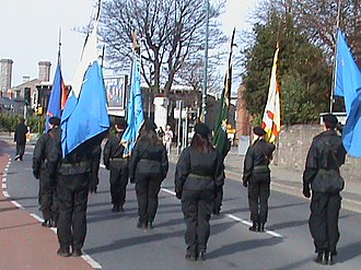 "Provisional Irish Republican Army - Republican colour party in Dublin, March 2009. The blue flag being carried at the front is that of ""Dublin Brigade IRA""."