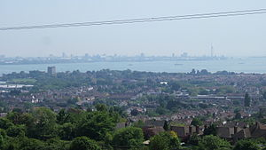 Portchester - View of Portchester from Portsdown Hill; castle keep on left, Portsmouth harbour and city in background