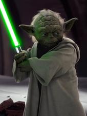 Yoda holding a lightsaber