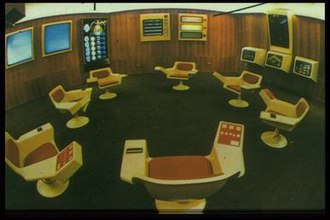 Project Cybersyn - The Operations Room (or Opsroom): a physical location where economic information was to be received, stored, and made available for speedy decision-making. It was designed in accordance with Gestalt principles in order to give users a platform that would enable them to absorb information in a simple but comprehensive way.