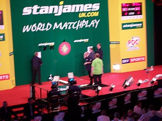 World Matchplay (darts) - A match in progress on the World Matchplay stage.