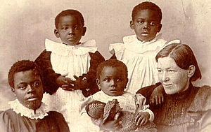 Mary Slessor - Mary Slessor with adopted children Jean, Alice, Maggie and May. Image taken in Scotland
