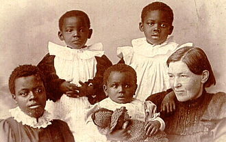 Mary Slessor is pictured with adopted children Jean, Alice, Maggie and May, in an image taken in Scotland Mary-slessor-and-adopted-children.jpg