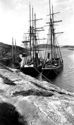 A sailing ship tied to shore, circa 1900-1920