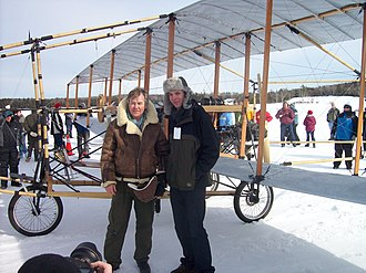 Bjarni Tryggvason - Bjarni Tryggvason and son Michael talking to the crowd after completing five flights on the Silver Dart replica on February 22, 2009.