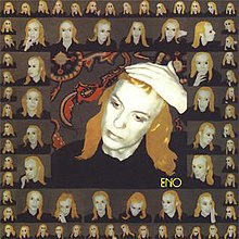 A picture of the album cover depicting a large image of Brian Eno with his hand on his forehead. Surrounding this photo is a frame of twenty unique photos of Eno. Surrounding that frame are 52 smaller unique pictures of Eno.