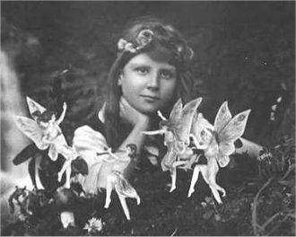 Cottingley Fairies - The first of the five photographs, taken by Elsie Wright in 1917, shows Frances Griffiths with the alleged fairies.