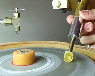 Faceting machine - A quartz gemstone being faceted