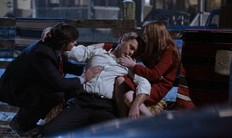 Reckoning (Smallville) - Jonathan dies in the arms of his son Clark and his wife Martha.