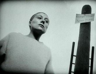 The Passion of Joan of Arc - Falconetti in a scene from the film. Dreyer dug holes in the set to achieve the low camera angles seen here.