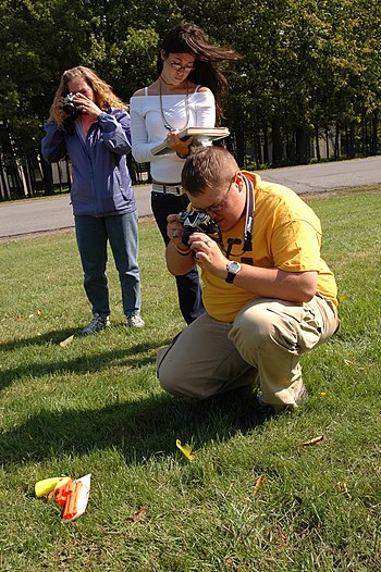 Students photographing evidence in SUNY Canton...