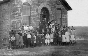 Silkville, Kansas - An 1884 photograph, showing students and teachers gathered at the Silkville school house.