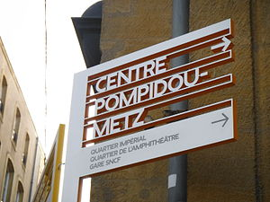 Centre Pompidou-Metz - Metz's signage systems created by Swiss designer Ruedi Baur indicating the direction toward the Centre Pompidou-Metz