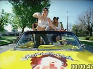 Hollaback Girl - Stefani on a Chevrolet Impala with the album cover art