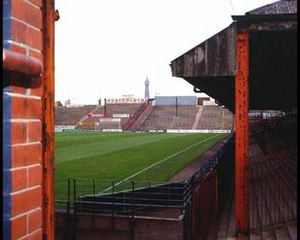 Bloomfield Road - A third view from the south-east corner of the ground in the 1990s. The Spion Kop, with Blackpool Tower in the distance.