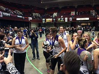 Scald Eagle - Scald Eagle holding the Hydra Trophy after her team Rose City Rollers won the 2015 WFTDA Championships.