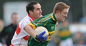 Seán Marty Lockhart - Lockhart (left) tackles Kerry's Colm Cooper in the 2009 National League