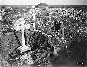 Ellis Wellwood Sifton - Two soldiers tending to the grave of Lance-Sergeant E. W. Sifton, February 1918