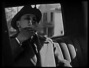 The Passaic Textile Strike (film) - Mr. Mulius enjoys a smoke to cap his amorous afternoon.