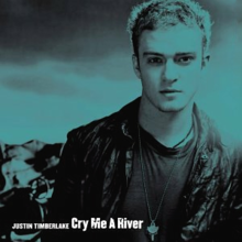 "A blueish colored portrait of a young blonde-haired man who is wearing a black shirt and a black leather jacket. In the left bottom corner is written his name ""Justin Timberlake"" and the track's title 'Cry Me a River' in white letters."