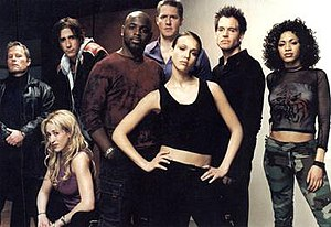 "Dark Angel (TV series) - The main characters of the first season from left to right: Col. Donald Lydecker, Kendra Maibaum, Calvin ""Sketchy"" Theodore, Herbal Thought, Reagan ""Normal"" Ronald, Max Guevara, Logan Cale and Cynthia ""Original Cindy"" McEachin."
