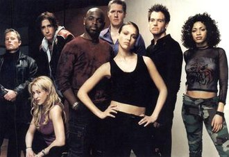 "Dark Angel (2000 TV series) - The main characters of the first season from left to right: Col. Donald Lydecker, Kendra Maibaum, Calvin ""Sketchy"" Theodore, Herbal Thought, Reagan ""Normal"" Ronald, Max Guevara, Logan Cale, and Cynthia ""Original Cindy"" McEachin."