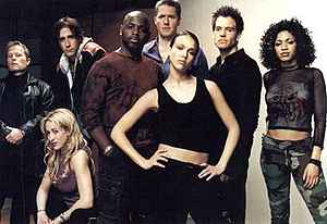 Eight reoccurring characters from the series first season posing for a promotional photograph