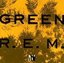"A golden yellow background with dark green impressions of leaves on it and the words ""GREEN"" and ""R.E.M."" written on top in black"