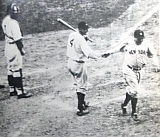 """1932 World Series - Ruth is congratulated by Gehrig after hitting his """"called shot."""" Gabby Hartnett, the Cubs catcher, watches."""