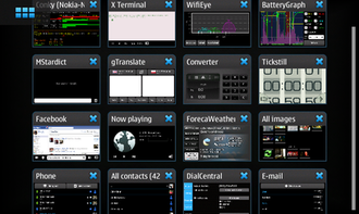 Nokia N900 - Maemo 5 dashboard showing running applications.