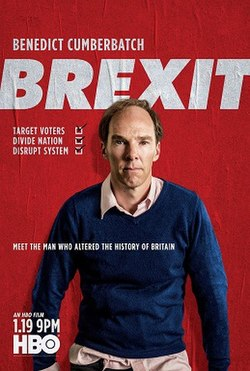 A balding man in a blue jumper, his untidy shirt sticking out at the edges. He standings against a red background, with the word Brexit in large white letters.