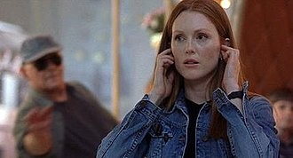 Clarice Starling - Julianne Moore as Starling in Hannibal; Lecter is in the background.