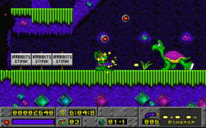 Jazz Jackrabbit (1994 video game) - In-game screenshot showing Jazz shooting at an enemy on Diamondus level, while profiting from temporary invincibility depicted by a field of yellow stars