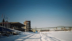 Venues of the 1976 Summer Olympics - 2006 picture of the canoeing-rowing basin with the finish tower on the left. West of the basin on the island is the Circuit Gilles Villeneuve.