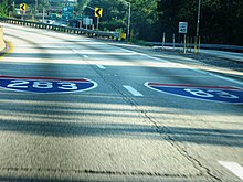Interstate Shields for I-283 and I-83 painted on the roadway.