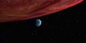 Red gas giant planet and distant small green moon