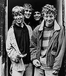 Black and white image of The La's standing in a doorway