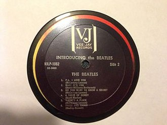 Introducing... The Beatles - A counterfeit Introducing... The Beatles label with the group's name and album title separated by the centre spindle hole