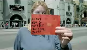 Dirty Little Secret - The video features anonymous people holding their secrets written on postcards.