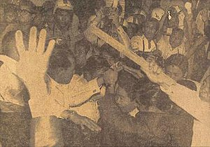 Ferdinand Marcos - January 26, 1970 – Rioters crowd Marcos and company as they enter his limousine. From Manila Bulletin.