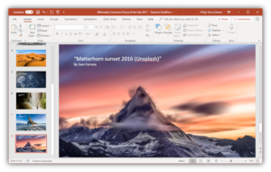 A photo presentation being created and edited in PowerPoint 2019, running on Windows 10