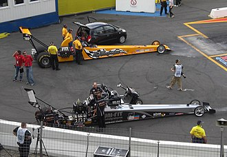 Top Alcohol - Two different types of Top Alcohol Dragster. Above, T/A injected dragster of Krister Johansson from Sweden; below, the supercharged methanol-burning car of Germany's Dennis Habermann.
