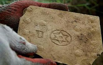Opoczno S.A. - One of the tiles found during the archaeological dig, providing the first physical evidence for the existence of the gas chambers at Treblinka