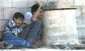 Muhammad al-Durrah incident - Muhammad and Jamal under fire