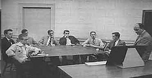 Asch conformity experiments - An example of Asch's experimental procedure in 1955. There are six actors and one real participant (second to last person sitting to the right of the table).