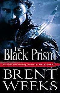 The cover of The Black Prism by Brent Weekswhich features a handsome, imposing man holding a blade.