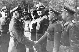 Franz Schädle - Schädle stands to the right of the soldier greeted by Himmler (left)