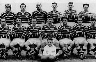 1951 NSWRFL season - Manly 1951 Grand Finalists. Back Row - Sandy Herbert, Gordon Willoughby, Roy Bull, Jack Hubbard, Fred Brown, Warren Simmons. Front Row - Ron Beaumont, Ken Arthurson, Jim Sullivan, Kevin Schubert (c), George Hunter, Ron Rowles, Jack Lumsden. Ball Boy W. Sullivan