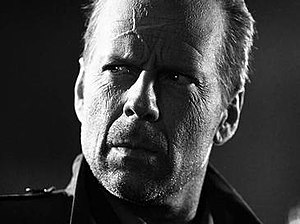 John Hartigan - Bruce Willis as Hartigan.